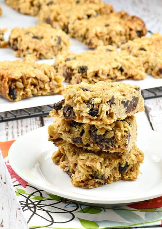 Homemade granola bars shown stacked on a white plate