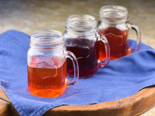 Three jars of kombucha with fruit showing the flavoring kombucha process
