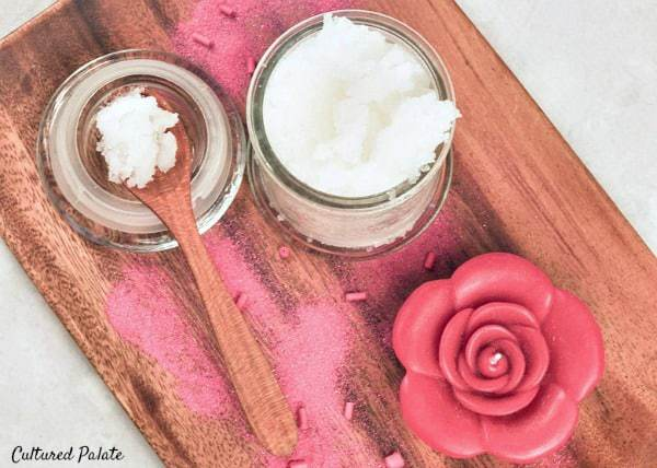 sugar scrub on wooden tray with a candle