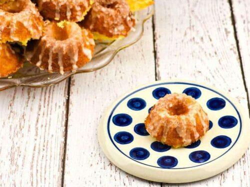 A photo of Lemon Supreme Tea Cakes on a blue and white plate
