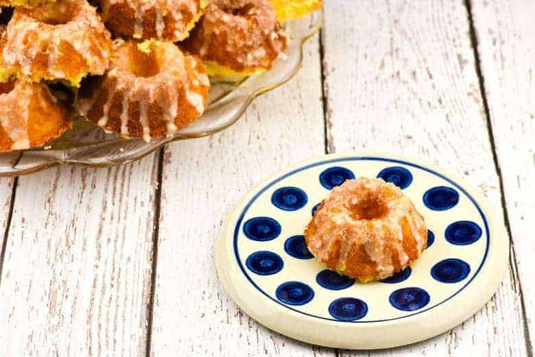 A photo of Lemon Supreme Tea Cakes on a blue and white plate