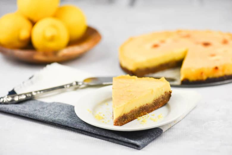 A side shot of a slice of easy lemon tart on a plate