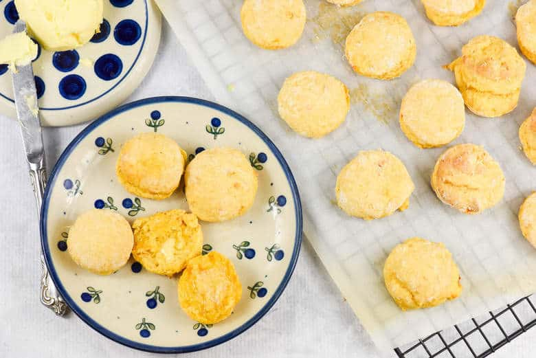 An overhead shot of Sweet Potato Biscuits on a blue plate and some on a tray