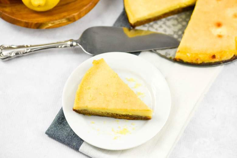 A photo of an easy lemon tart with a slice cut out