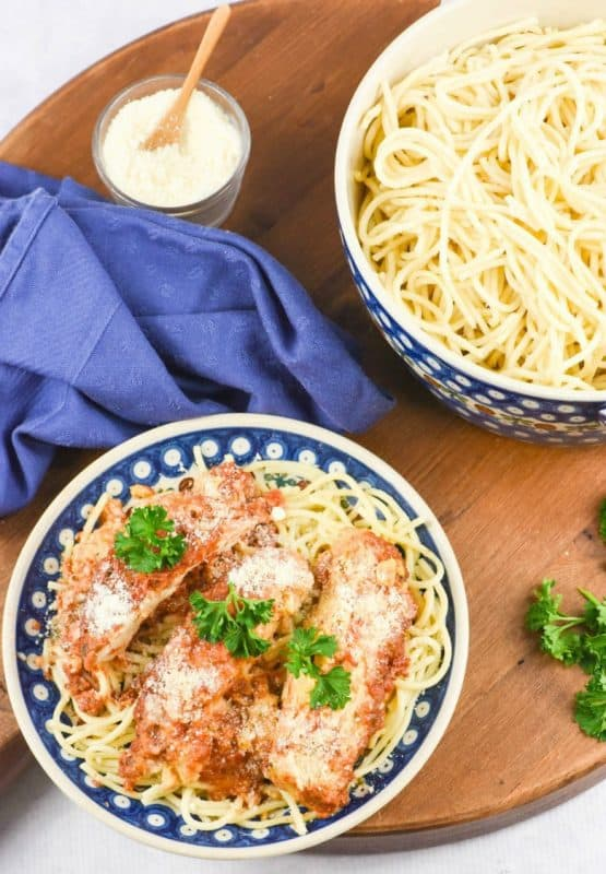 Chicken Parmesan on plate of noodles made from Crock Pot Chicken Parmesan recipe