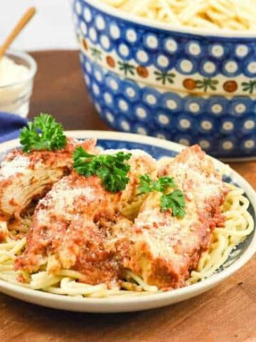 A close up of Crock Pot Chicken Parmesan with spaghetti