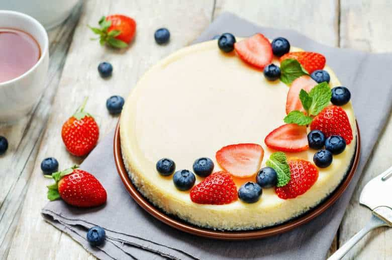 Sour Cream Cheesecake, an easy cheesecake recipe, topped with berries.