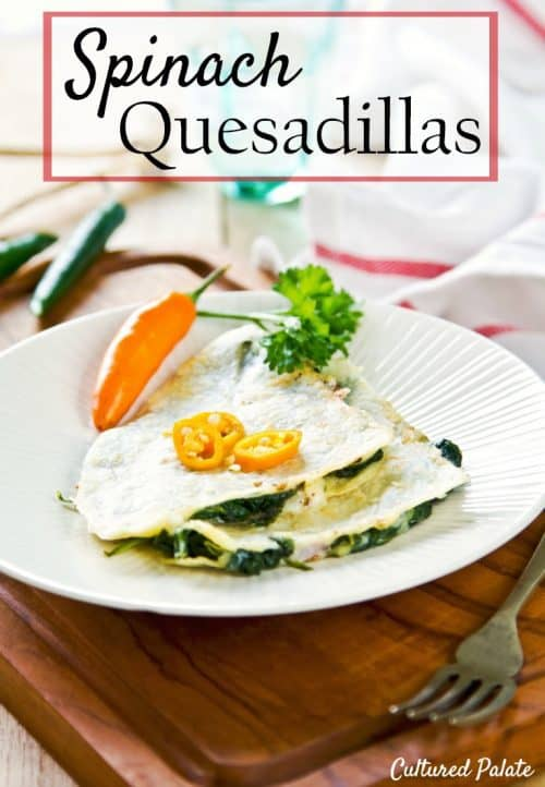 Quesadilla on white plate with pepper and table set made from Easy Spinach Quesadilla Recipe