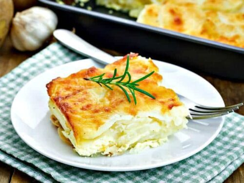 A close up of Easy Scalloped Potatoes on a white plate