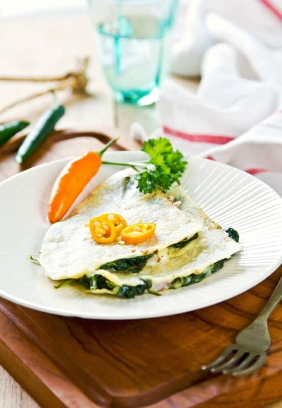 Quesadilla on white plate made from Easy Spinach Quesadillas Recipe