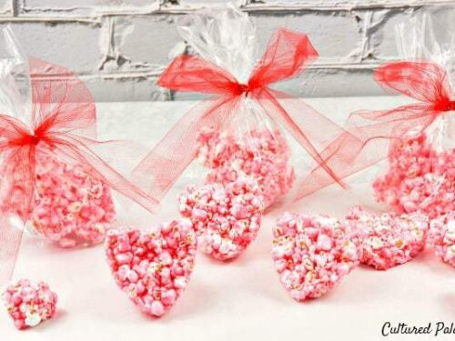 heart shaped popcorn balls in red and pink wrappers