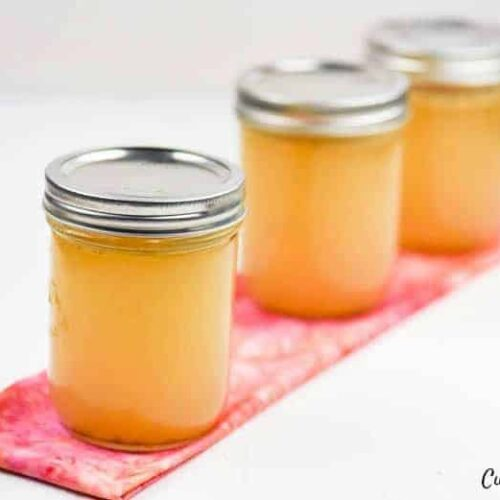 how to make chicken broth - 3 jars of broth shown