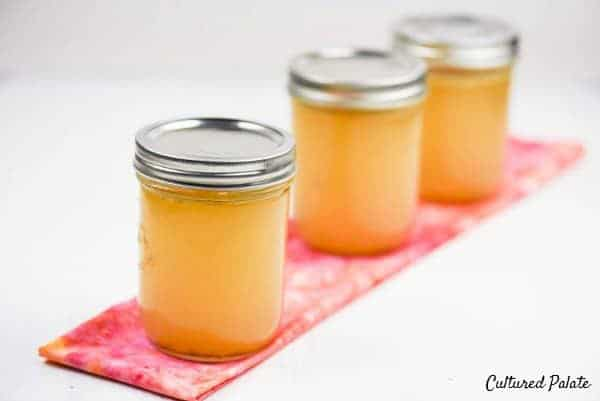 how to make chicken broth image showing jars of broth