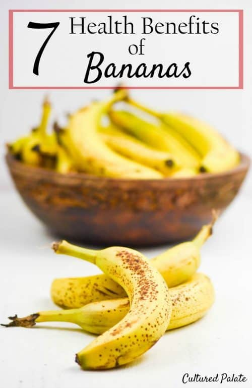 Health Benefits of Bananas - ripe bananas shown in wooden bowl and on table with post title