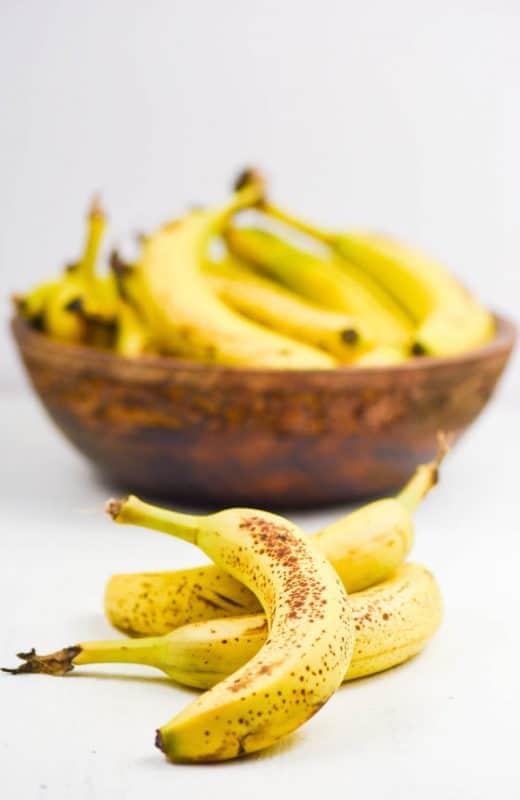Health Benefits of Bananas - bowl of bananas shown on table