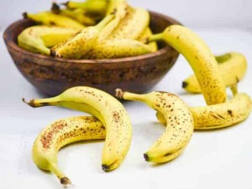 wooden bowl of ripe bananas