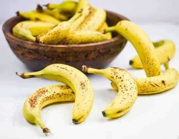 wooden bowl of ripe bananas