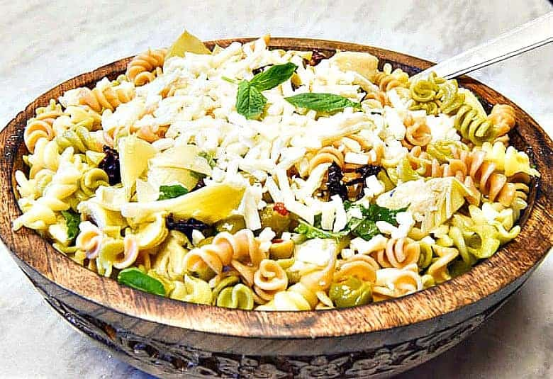 Italian Pasta Salad shown in a wooden bowl ready to serve