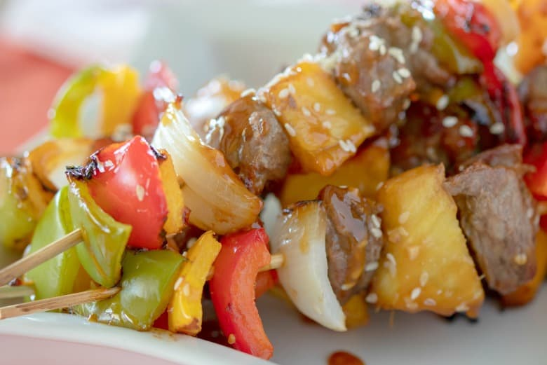 Kabob recipe shown with peppers onions beef and pineapple