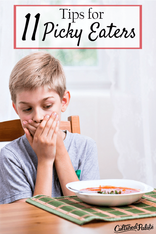 Picky eaters illustrated by Young boy shown with hand over mouth in front of a bowl of soup