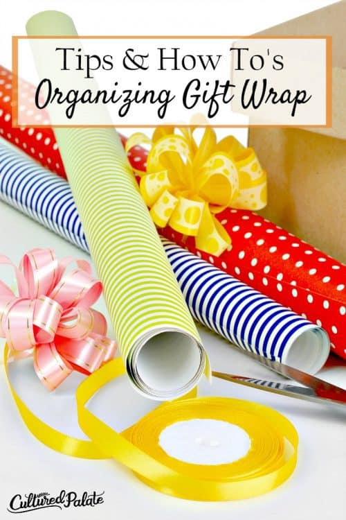 Titles Vertical image of Gift wrap, ribbon, bows and box shown with scissors from the post Organizing Gift Wrap