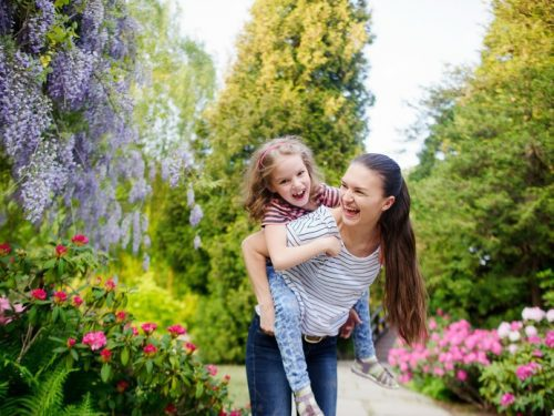 Horizontal image of Mother and daughter shown having fun in the park from the post 7 Parenting Tips to Enjoy Your Child