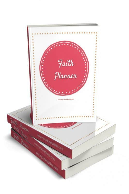 Vertical image of the Faith Planner - one standing on top of three laying down
