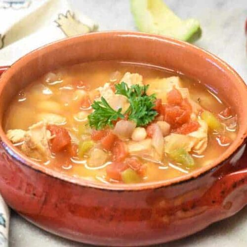 close-up of red bowl of instant pot white chicken chili