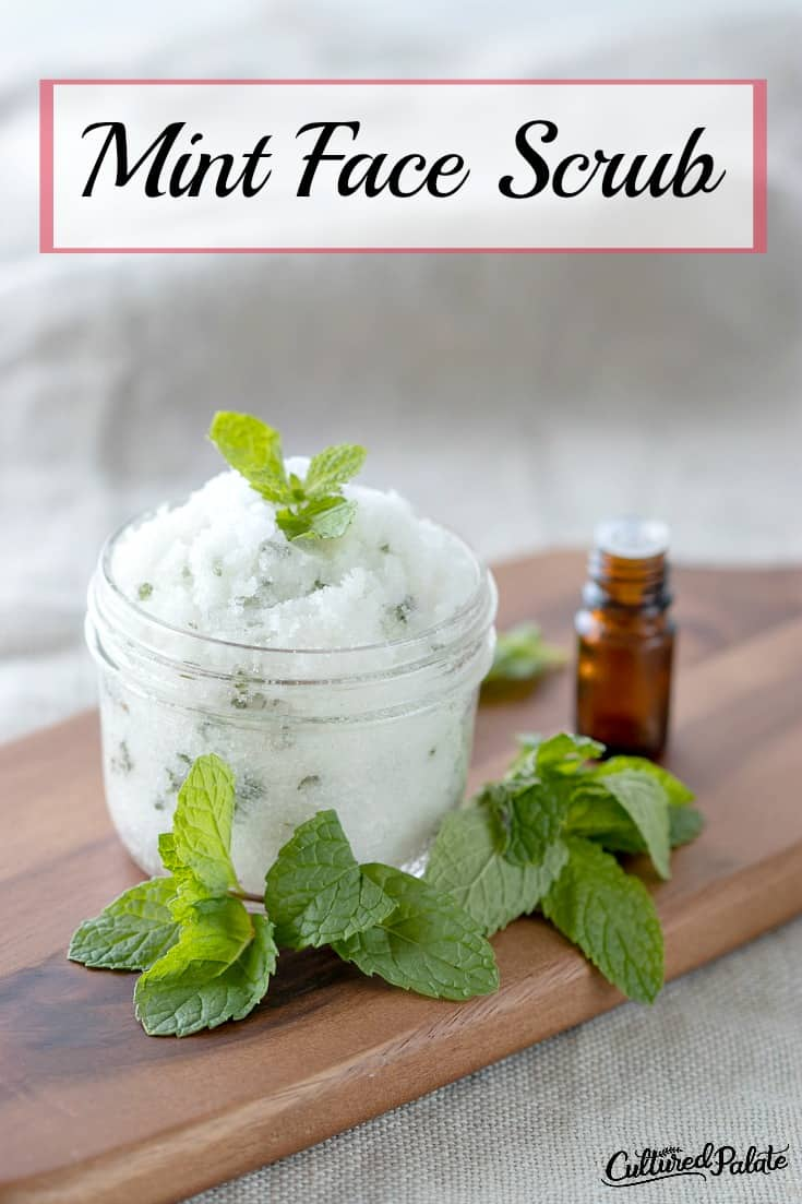 Sugar Scrub - Mint Face Scrub is shown in glass jar with mint leaves and essential oil bottle with text overlay