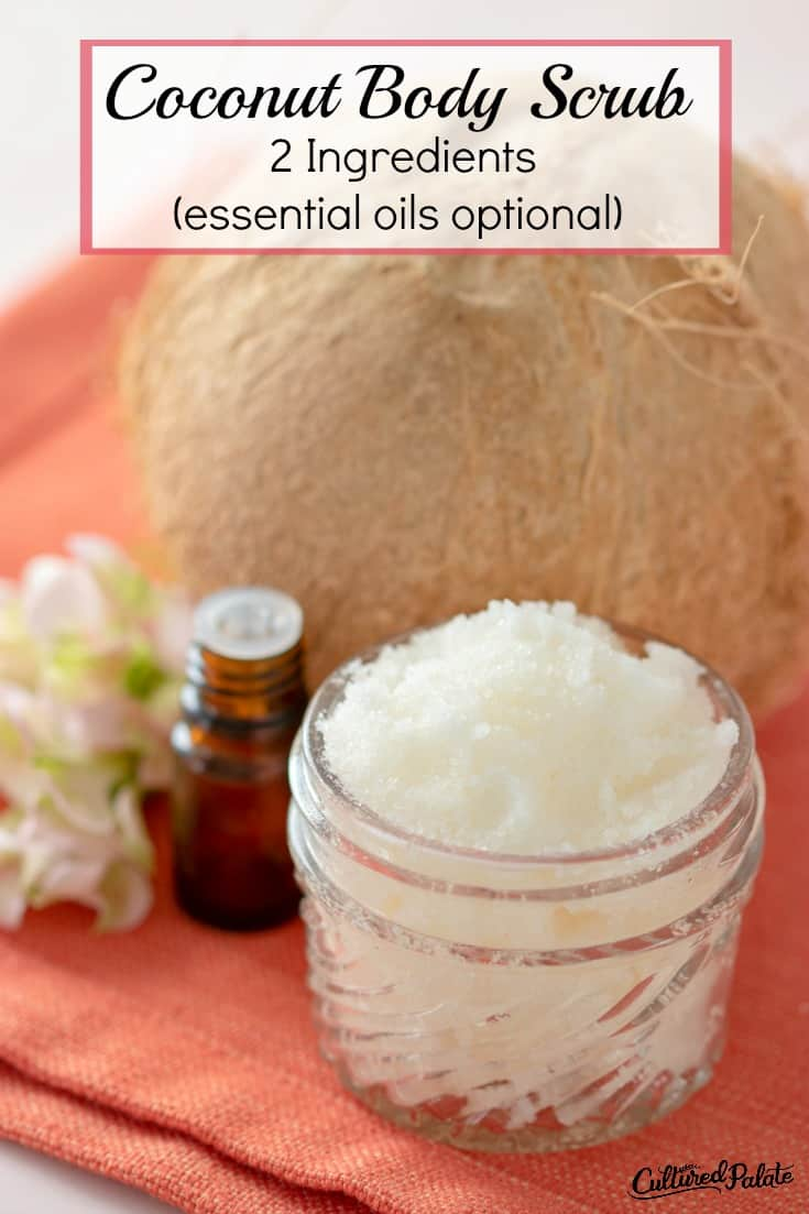 Coconut Body Scrub Recipe shown in glass jar with coconut and essential oil around it and text overlay.