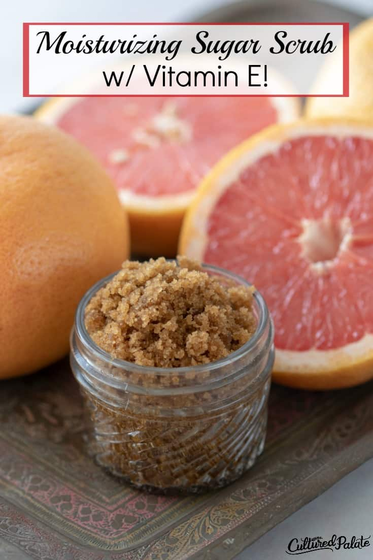 Moisturizing Sugar Scrub shown in glass jar with grapefruit around on tile with text overlay.
