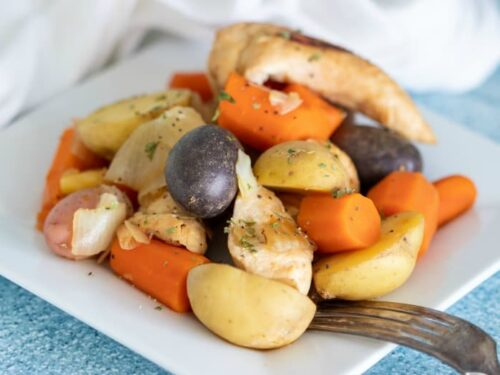 Complete Chicken Dinner in Crockpot shown in horizontal image on white plate.