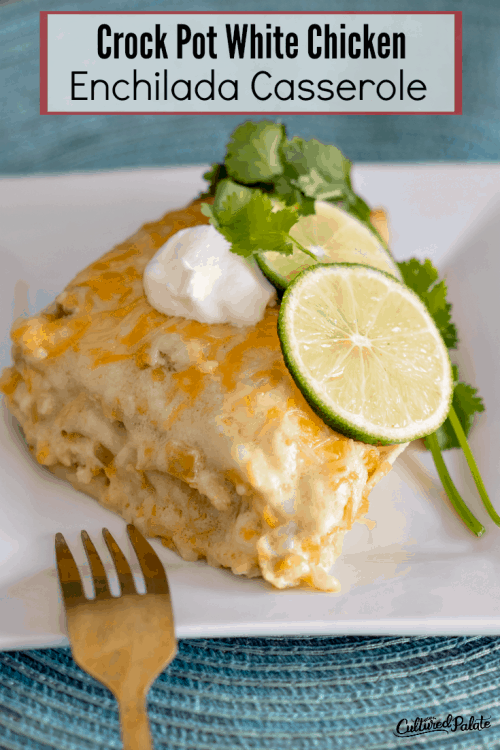 A piece of CrockpotWhite Chicken Enchilada Casserole on a white plate with fork to the side with text overlay.
