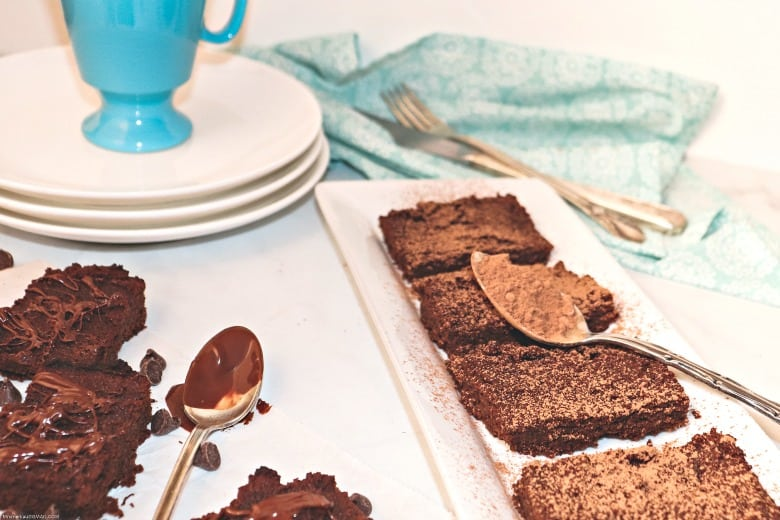 GAPS brownies shown on rectangular plate with white plate and blue cup in the background.