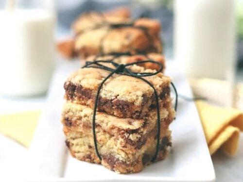 Keto Butterscotch Brownies shown closeup stacks three to a bundle.