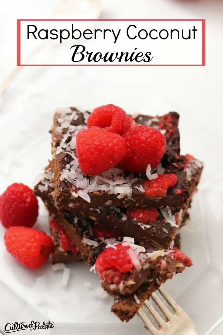 Raspberry Coconut Brownies show from overhead with raspberries on top and text overlay.