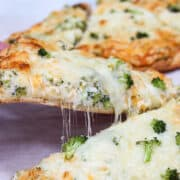 cut naan pizza with cheese