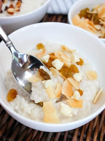 cream of rice in a white bowl with a spoon