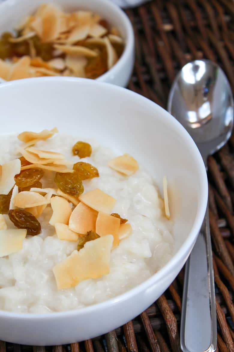 rice in a bowl with coconut and raisins