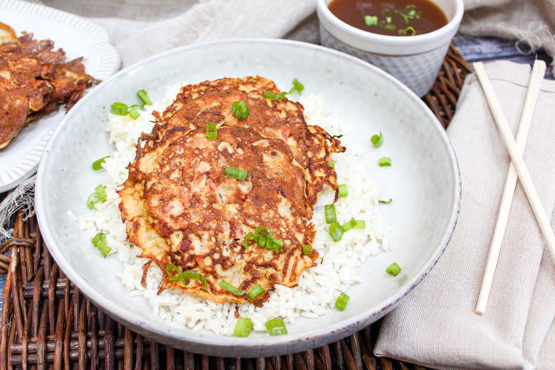 Egg Foo Yound pancakes over rice in a bowl